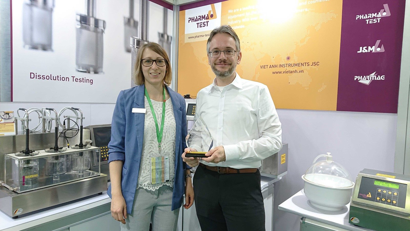CEO Björn Fähler at analytica Vietnam 2019 accepting a reward for Pharma Test for participating at the 10th anniversary of the exhibition