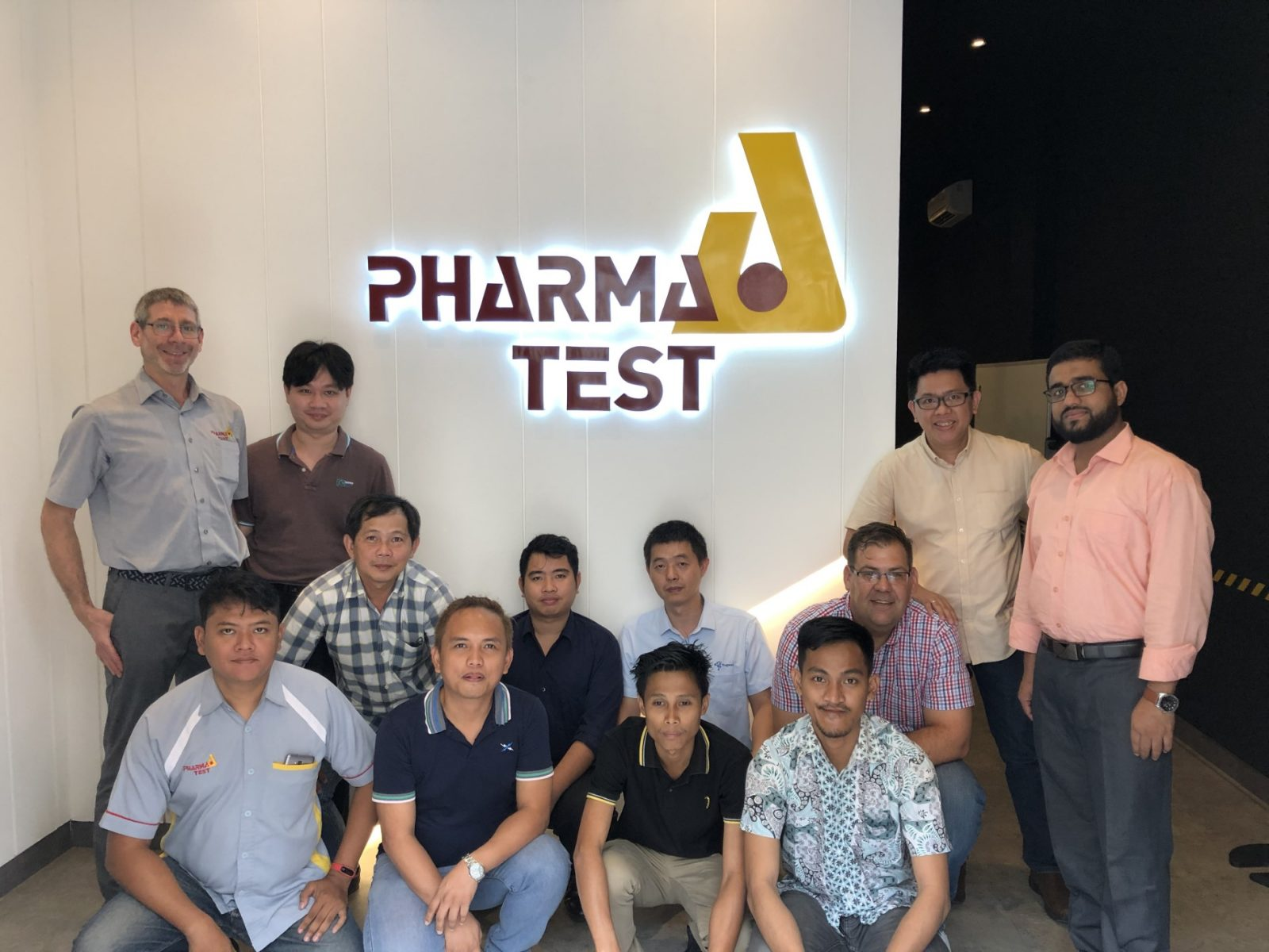 Group picture at the PT. Pharma Test Indonesia office located in Green Lake City, Tangerang near Jakarta